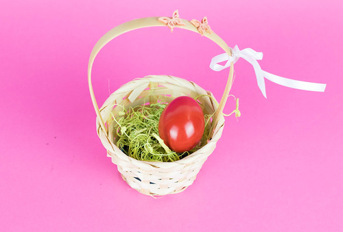 Red Easter egg in a basket