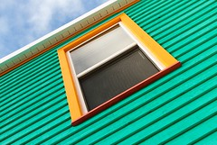 Window (Karen_Chappell) Tags: green window tilt angle architecture home house paint painted wood wooden city urban stjohns downtown jellybeanrow rowhouse yellow orange trim clapboard lines geometry abstract newfoundland nfld atlanticcanada canada avalonpeninsula rectangle geometric white blue
