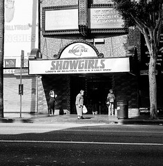 showgirls (gguillaumee) Tags: film analog grain square mediumformat fujineopanacros rolleiflex stripclub holywoodboulevard ladies women standing waiting sidewalk streetphotography candid street bw blackandwhite