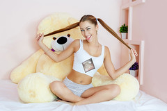 Beautiful  Woman at bed  with a big toy bear. (casinolifepokerapp) Tags: woman female person face eyes one hair caucasian cute beauty beautiful attractive tender young lovely brunette pretty happy sexy seductive coquettish flirty pleasure relax peaceful relaxation bed linen bedroom leisure white calm pillow awake morning smile rest healthy appearance resting emotions indoor comfort alone lying toy bear