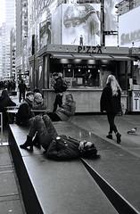 Times Square Rest Stop (crop) (sjnnyny) Tags: afsnikkor24853545gvred timessquare theaterdistrict tourists sightsee candid people d7500 sjnnyny stevenj pedestrianplaza nyc manhattan signage broadway 42street