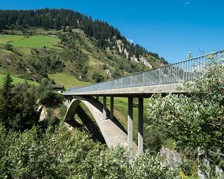 RHE105 Platta Road Bridge over the Medelser Rhein River, Platta / Medel, Grisons, Switzerland