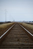 Tracks (' A r t ') Tags: track rails sky lines grass dof depth field pylon power poles electicity electricity