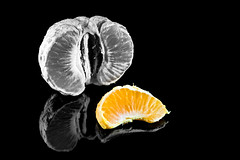 Satsuma (roseysnapper) Tags: heliconfocus ledlighting niksoftware nikkor105mmmicrof28 nikond810 silverefexpro20 blackbackground closeup colourpopping focusstack lightroom photoshop citrus fruit satsuma macro