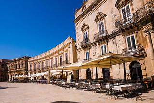 Cafes in Sicilian Baroque style buildings in Piazza Duomo, Ortig