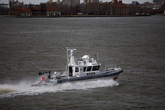 Daily life imagery shot from the Staten Island Ferry on Tuesday, March 13, 2018. Benjamin Kanter/Mayoral Photo Office. (nycmayorsoffice) Tags: nyc newyork newyorkcity pd boat cop cops dailylife nypd police unitedstates us