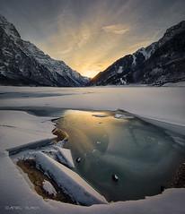 Broken Ice (Dani Maier) Tags: glarus schweiz ch klöntal klöntalersee alpen alps frozen ice eis snow schnee sunset sonnenuntergang bergsee mountainlake