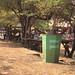 Waste bin in front of fruit stall