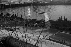 Abandoned Pier, Brooklyn (josephkrings) Tags: 1stavenue abandoned brooklyn greenwoodcemetery ilfordhp5 newyork nikkor28105mm13545 nikonn70 sunsetpark blackandwhite pier