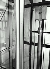 Scenes from an elevator (frankdorgathen) Tags: iron metal transportation mundane banal banaliy vertical monochrome blackandwhite technical glass indoor elevator