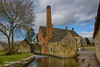 The Mill at Lower Slaughter (Holfo) Tags: yellow mill cotswolds hdr nikon d750 oxofrdshire lowerslaughter old timegoneby building sky tree traditional chimney stone england waterwheel stonewall brick pasttimes rural