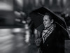 Rain is simple, umbrella is simple; umbrella under rain is the magical meeting of these beautiful simples -Mehmet Murat ildan- (Lorrainemorris) Tags: people monochrome portrait creativephotography artistic thinking rain umbrella batis sony7rm2 blackandwhite mono edinburgh streetphotography