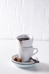 cup of black coffee on a saucer with brown sugar on a white background (lyule4ik) Tags: coffee drink espresso cup beverage breakfast white hot mug cafe brown caffeine black aroma isolated liquid porcelain filter top break fresh foam latte mocca organic view decaf morning aromatic bio food shop coffeecup cappuccino bean pleasure coffeebeans coffeefoam object energy plate restaurant grain background italian small table spoon close