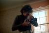 1a-382 (ndpa / s. lundeen, archivist) Tags: nick dewolf nickdewolf photographbynickdewolf 1977 1970s color 35mm film 1a reel1a aspen colorado fall autumn november rockymountains foxhunt hunt woodycreek woodycreekhounds roaringforkvalley afterthehunt socializing woman photographer camera mediumformat mediumformatcamera tlr lens takingpictures takingphotographs curlyhair glasses sunglasses shades meal breakfast huntbreakfast