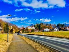Mühlbach near Oberaudorf in Bavaria, Germany (UweBKK (α 77 on )) Tags: mühlbach oberaudorf bayern bavaria deutschland germany europe europa street road path weg lamp post blue sky white clouds village field winter cold iphone