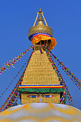 The Eyes of Bodnath (Aubrey Stoll) Tags: bodnath temple eyes budhism buddhism religion flags colours blue sky kathmandu nepal asia hinduism dome stupa decorations travel tourism pilgrimage pilgrims holy devotees god gods messages white