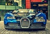 The Stable Of Wild Horses (HiJinKs Media...) Tags: car power bugatti speed horsepower reflections city horses wild fast velocity buildings windows blue black chrome veyron bricks contrast colours colors colori colores automobiles auto w16
