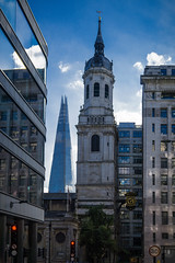 Towers (one steeple is higher than the other ;) (Мaistora) Tags: building architecture church belltower steeple spire skyscraper tower plaza shard tallest pointed sharp glass reflection reflections windows sunset sunlight sunshine sky clouds blue white trees traffic lights shadows facade offices timepiece clock city squaremile momument london sony alpha ilce a6000 sel1650pz epz1650mmoss lightroom