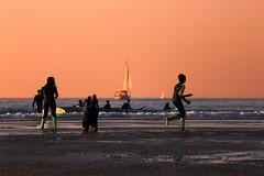 Bathing & sailing at sunset - Tel-Aviv beach - Follow me on Instagram:  @lior_leibler22 (Lior. L) Tags: bathingsailingatsunsettelavivbeach bathing sailing sunset telaviv beach telavivbeach israel sailboat people running