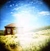 bodie. (shoegazer.) Tags: bodie california diana toycamera kodake100vs crossprocessed xpro vignette ghosttown sky clouds grass gloom 2012