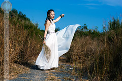 Flying Gown (Hosting and Web Development) Tags: 新疆 xīnjiāng portrait summer asia d7100 chândung nikon grass dress sunlight cỏcháy road white vietnam sky costume braid young person one nature happy horizontal stand hay afternoon hair face shoulder arm body