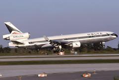 N891DL- MCDonnell Douglas MD-11P - Delta - KMCO - Aug 1992 (peachair) Tags: n891dl mcdonnell douglas md11p delta kmco aug 1992 cn 48411 453 orlando msn florida mco livery old mitsubishi
