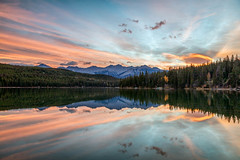 Splattered with Color (Kirk Lougheed) Tags: alberta canada canadian canadianrockies jasper jaspernationalpark pyramidisland pyramidlake rockymountains autumn dawn fall forest lake landscape mountain nationalpark outdoor park reflection sunrise water