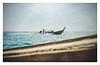 Solitary ride (Alex E. Milkis) Tags: kohphiphi thailand sail boat water sea sun moment catch splendid capture warm wind explore adventure honeymoon exotic shore mountains wood d810 2470