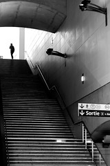 At the top of the main staircase (pascalcolin1) Tags: paris13 homme man lumière light ombres shadows escalier staircase photoderue streetview urbanarte noiretblanc blackandwithe photopascalcolin 50mm canon50mm canon