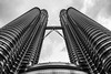 The Petronas Towers (D. R. Hill Photography) Tags: petronas petronastowers petronastwintowers towers skyscrapers buil building architecture city urban modern capital asia southeastasia lookingup malaysia blackandwhite monochrome travel nikon nikond750 voigtlander voigtlandercolorskopar20mmf35 colorskopar cosina 20mm wideangle manualfocus primelens fixedfocallength