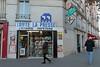 Paris 15ème - Paris (France) (Meteorry) Tags: europe france idf îledefrance paris spaceinvader spaceinvaders invader invaderwashere mur wall street rue art artderue pixels pa1279 boulevardlefebvre rueléondierx 75015 toutelapresse librairie pepeterie bookstore storefront people streetscene corner coin trottoir pavement blue bleu big november 2017 meteorry