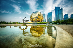 The Dancer and the Mirror (Andy Brandl (PhotonMix)) Tags: cityscape modern reflections mirror architecture china photonmix hdr sky water pool globe clouds