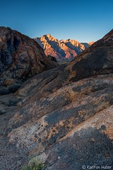 Lone Pine Peak, Alpine Glow - [Explore - March 18, 2018] (www.karltonhuberphotography.com) Tags: 2017 alabamahills alone alpineglow bluesky california calm depthoffield easternsierra exploring fallcolorstrip firstlight foregroundinterest geology karltonhuber landscape light lonepinepeak morninglight mountain mountainpeak nature outdoors quiet rocks still sunrise verticalimage