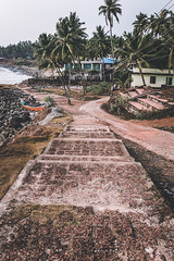 Down the Stairs (Top KM) Tags: coastline beach boardwalk shore coast shoreline seashore waterfront jetty palm trees stairs india tropical rural outdoors outdoor outside coastal seaside pier travel daylight daytime natural light day boat dock steps stairway sidewalk