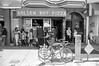 golden boy pizza (Super G) Tags: scans061911 film sanfrancisco california nikonn80 50mm streetphotography blackandwhite woman man standing pizza