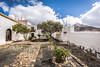Church garden (DC P) Tags: little white church canary islands island spain sky nature old historic historical history hill hiking angle adventure beautiful bej canon color cloud clouds dof digital explore fantastic hdr landscape light ngc outdoor outside outdoors pov panorama paradise serene sun travel trekking view wideangle world sony a7rii metabones religion grass road tree ermita de san agustín tefia fuerteventura garden cross mountain kapel wall historisch