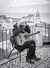 interlude (slavamanc) Tags: streetmusician oldman busking street guitarist seaview terrace lisbon alfama oldtown portrait expression candid blackwhite monochrome