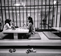 Conversation Now (rizqyunggul) Tags: amateur jakarta indonesia people streetphotography blackwhite candid indoor urban restaurant