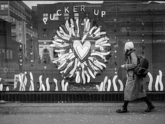 Northern Quarter 200 (Peter.Bartlett) Tags: manchester bag noiretblanc shopfront window unitedkingdom people woman facade olympuspenf walking urbanarte urban reflection streetphotography hat lunaphoto girl shopwindow monochrome uk m43 microfourthirds peterbartlett bw niksilverefex sign blackandwhite candid city england gb