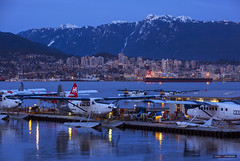 Sea To Sky (Clayton Perry Photoworks) Tags: vancouver bc canada explorebc explorecanada northvancouver skyline northshoremountains airplane seaplane harbourair reflections night lights