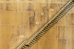 Stairway and an old storage tank (Jan van der Wolf) Tags: map156186v staircase stairway stairs monochrome monochroom shadow shadowplay schaduwen schaduwspel storagetank opslagtank lines lijnen playoflines interplayoflines lijnenspel