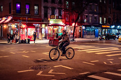 New York (KennardP) Tags: bicycle manhattan newyorkcity nyc canon5dmarkiv 5dmarkiv sigma50mmf14dghsmart sigmaartlens canon sigma cityatnight citylights nightlights nightphotography handheldnight delivery store restaurant people road cars