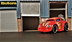 VW Beetle Custom Hot Rod. (ManOfYorkshire) Tags: diecast car auto automobile vw beetle volkswagen garage diorama detailed modified hotrod custom red short shortened flames wheels decals customised headlights roller shutter doors unit workshop shop