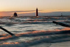 Sunlight Rides the Waves (matthewkaz) Tags: grandhaven pier grandhavenlighthouse lighthouse lakemichigan lake water greatlakes driftwood log wave waves winter sunset sky clouds nocatwalk michigan 2017