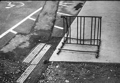 bicycle rack, parking lot, pavement, painted symbols, sidewalk Asheville, NC, FED 4, Arista.Edu 200, Ilford Ilfosol 3, 3.3.18 (steve aimone) Tags: bicycle rack bicyclerack pavement parkinglot paintedsymbols sidewalk asheville northcarolina fed4 industar26 aristaedu200 moerschecofilmdeveloper 35mm film rangefinder blackandwhite monochrome monochromatic urbanlandscape