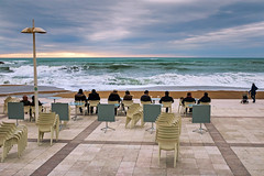 Watching the Waves (Ktoine) Tags: sky dramatic landscape biarritz basque plaza terrace terrasse chairs cafe light clouds people show waves