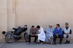Chilling, in Marrakech (ambfotos1) Tags: youngmen oldmen friends cellphone streetscene city groupofmen sitting citybench maroc morocco marrakech
