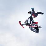 Snowmobile jump high in the air thumbnail