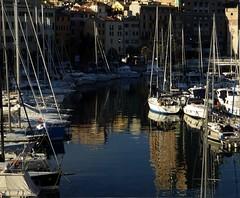 riflessi al porto (fotomie2009) Tags: porto harbour reflection riflesso boat barche imbarcazioni sea mare savona liguria italy italia torretta torre leon pancaldo