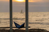 A penny for your thoughts? (matthew:D) Tags: blue beach ocean sunset wet water color lighting sailboat hammock yellow pillar waves